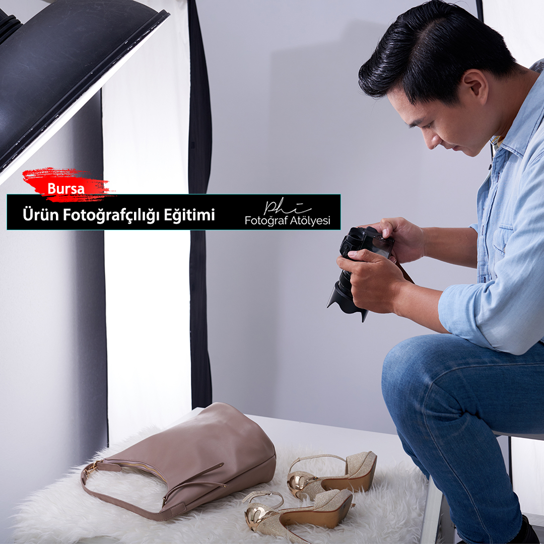 Young Vietnamese man taking photos of fashion items in studio
